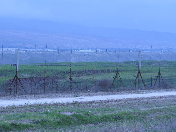 Border fences and Jordanian villages