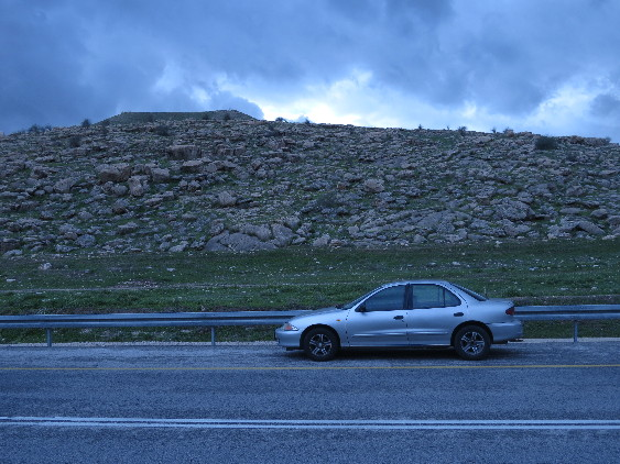 My then-Chevy with rocks and clouds. Rt. 90