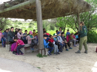 Soldier girl mentoring a school group visiting Neto Kedumim