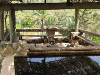 Grain shaker with grinding stone, and pond. Neot Kedumim