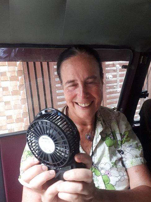 Fanning myself on the tuktuk with my little Israeli device