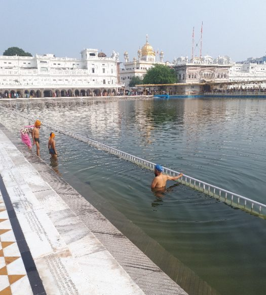 Amritsar Golden Temple. Holy water immersion. Males only