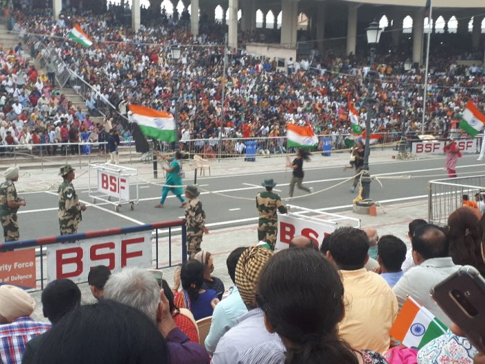 Amritsar border ceremony. Women running with flags, taunting Pakistanis