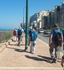 Group walking along beach. Netanya