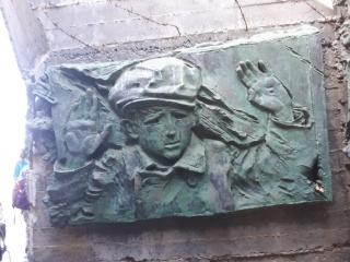 Jewish child surrendering to Nazis. Holocaust memorial. Netanya promenade