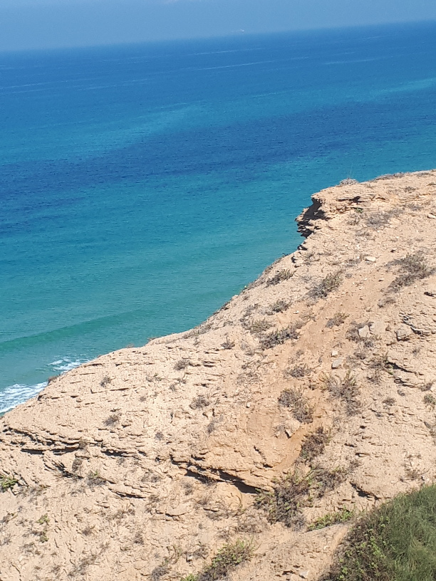 Kurkar beach rock overlooking sea. Netanya