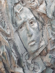 Memorial for Red Army Victory and the Holocaust. Relief of suffering woman In the bunker