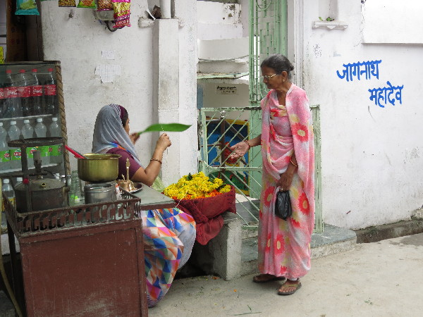 Selling flowers for puja ceremony, Udaipur alley, Rajasthan