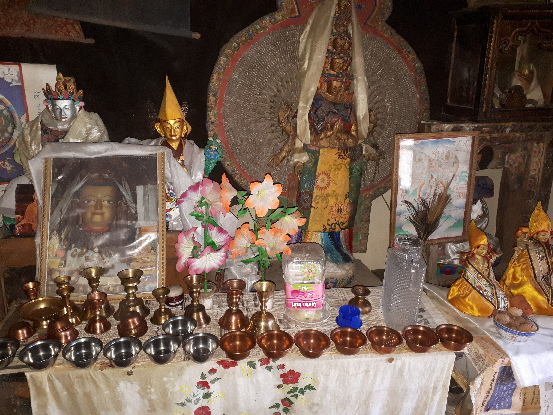 Home temple with sacred pictures and artifacts, Ladakh