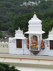 Ganesha with escorts ovelooking forest view