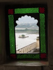 Lake and island framed in window. Udaipur City Palace, Rajasthan