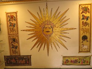 Local art - powerful sun image in gallery by river, Udaipur, Rajasthan