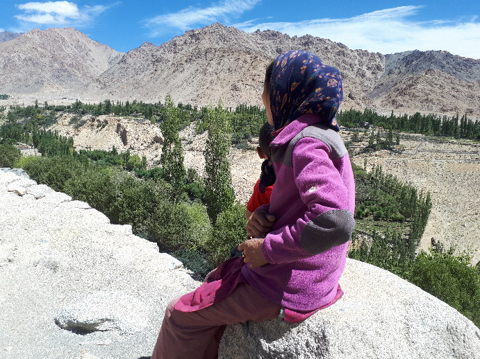 Likir - a village woman looking over view, Ladakh