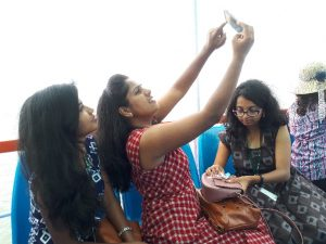Students taking selfies on boat to Elephanta Island