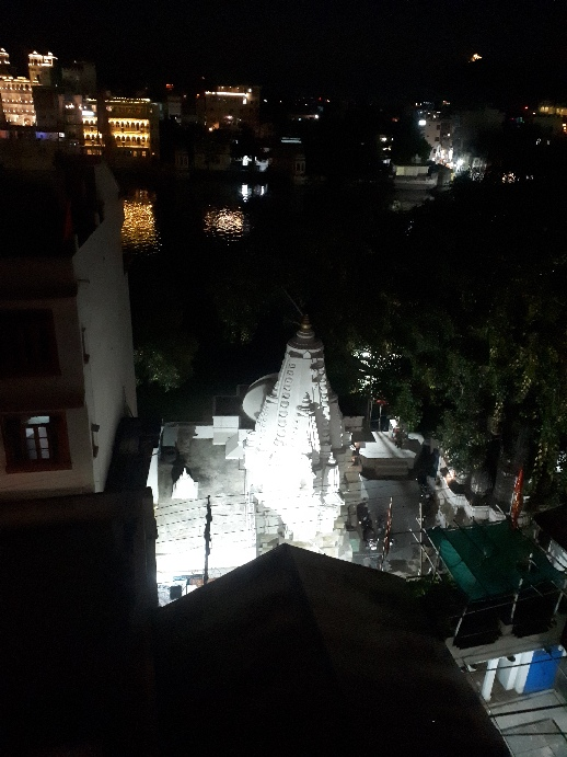 Temple illuminated, viewed from Minerva Hotel rooftop, Udaipur