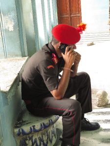 The guard and the cellphone at city palace