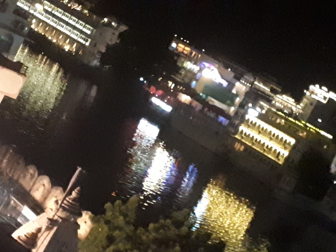Udaipur City at night viewed from Nukkad Hotel rooftop, Rajasthan