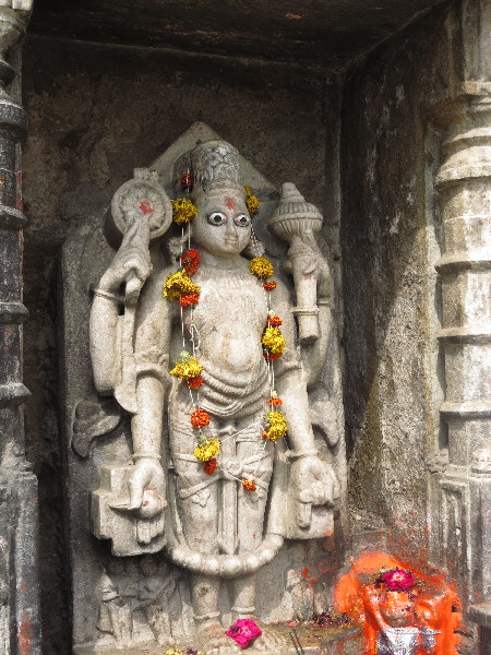 Deity on temples front. perhaps Bhagwas Shani Dev. near Udaipur City Palace, Rajasthan