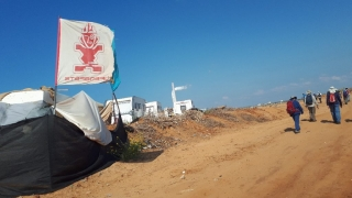 Almagor hiking group passing by squatters colony, Hadera, Israel