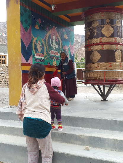 Rinchen, Stanzin and old woman by prayer wheel. Likir