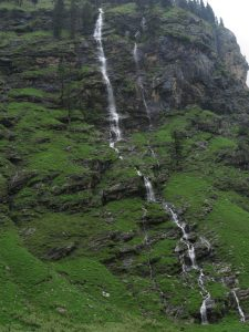 Water cascading down a high Himalayan mountain on the road from Manali to Leh, Himachal