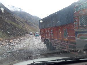 Colorful Himalayan trucks on road from Jispa to Leh
