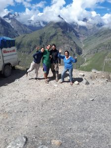 The gang posing against snowy peaks on road from Manali to Leh, Himachal Pradesh