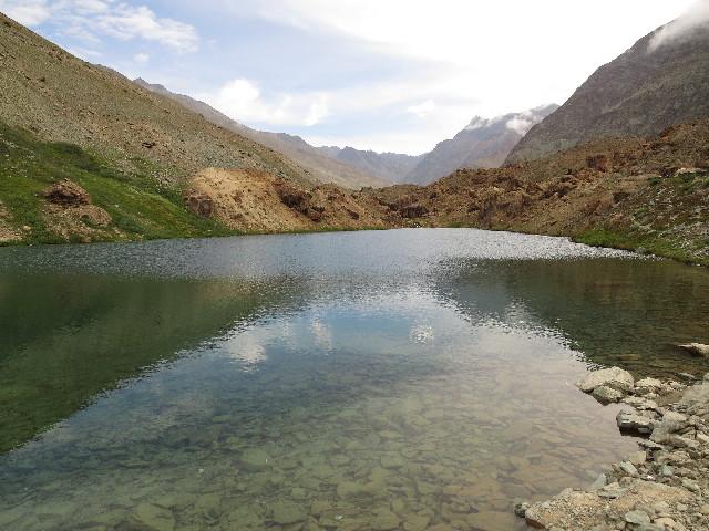 Pristine lake at border between Himachal and Ladakh, on road from Jispa to Leh