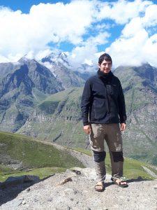 Yair posing against Himalayan snowy peaks. Northern Himachal Pradesh