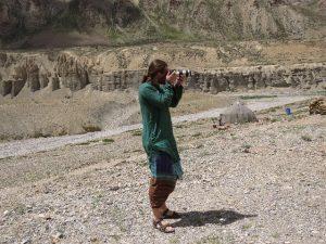 Bram shooting a pic by river on road rom Jispa to Leh