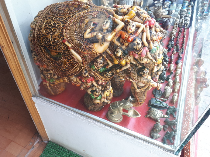 An extraordinary elephant decorated with asparas displayed in shopwindow in Leh
