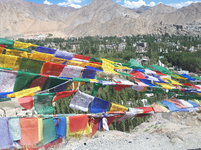 Buddhist flags flying on way to Shanti Stupa, Leh