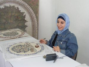 Mosaic artisan creating a piece. Jordan.