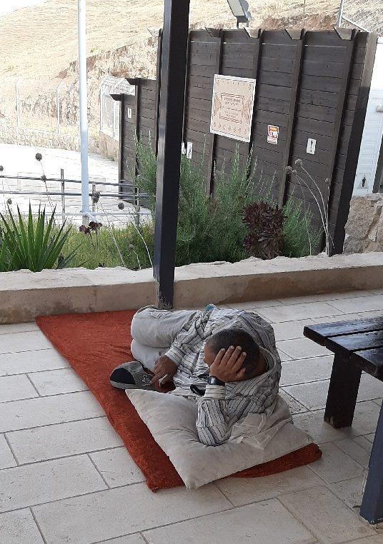 Arab worker at the Good Samaritan Inn taking a rest over Ramadan