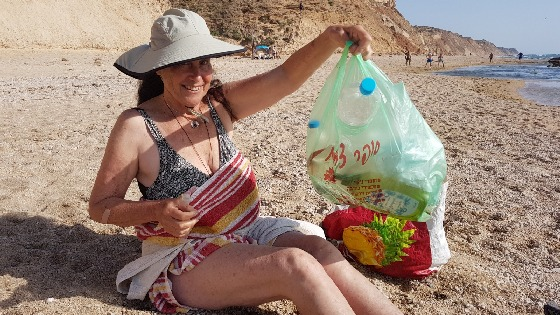 Collecting garbage from the beach. Apollonia