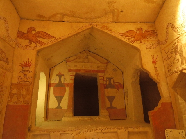 Entrance to tomb cave with frescoes of amphorae and eagles on a wreath. Beit Guvrin