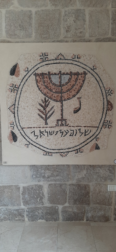Peace Over Israel and a menorah from jericho Synagoguge. Good Samaritan Museum
