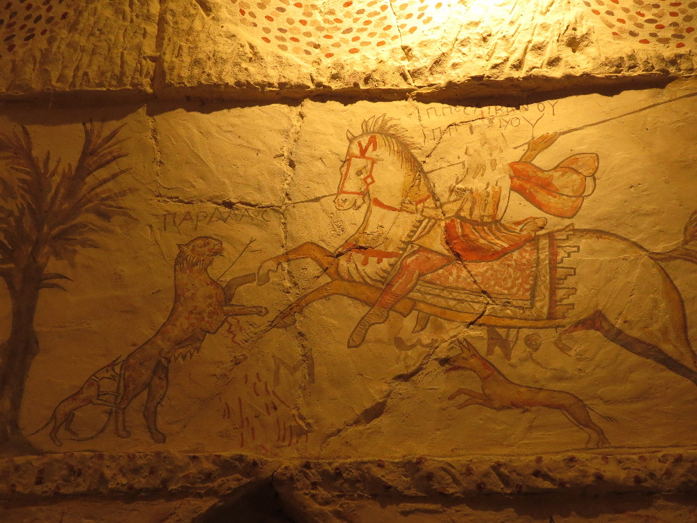 Rider fighting a leopard with dogs. Apollophanes Cave. Beit Guvrin