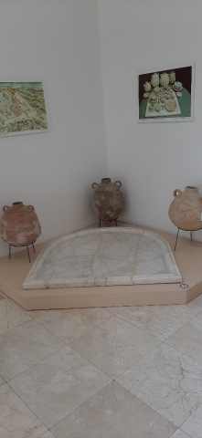 Marble tables from Martyrius Monastery and ceramic vessels