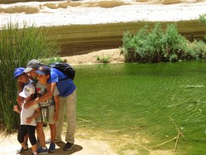 Family wathing water at Ein Avdat National Park