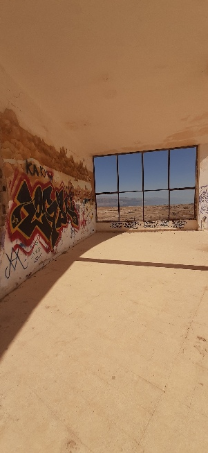 Graffity at Lido's abandoned army base with window view