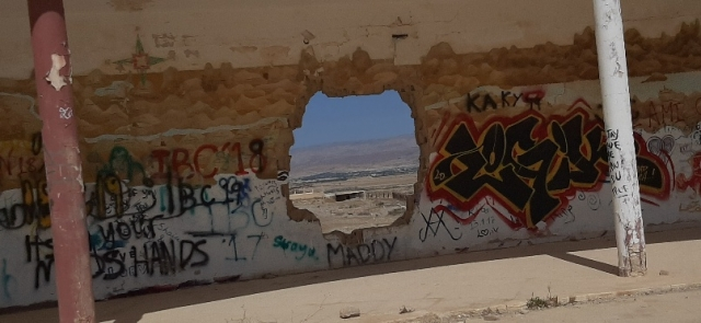 View of dead Dead Sea through hole in wall. Old British camp, Lido