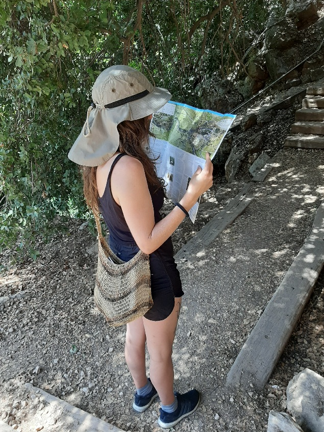 Ela looking at Banias Reserve's pamphlet
