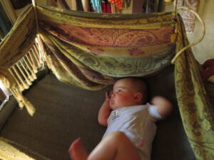 Sinaya in her cradle. Yashar's and Sofia's tent-house