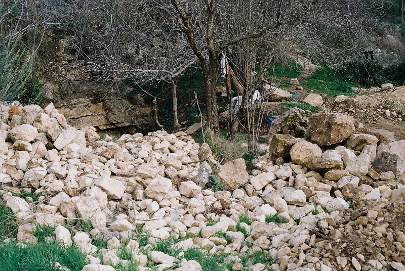 Pre renovation. The stones and rocks dumped by the D-9 into Ein Sapir Spring
