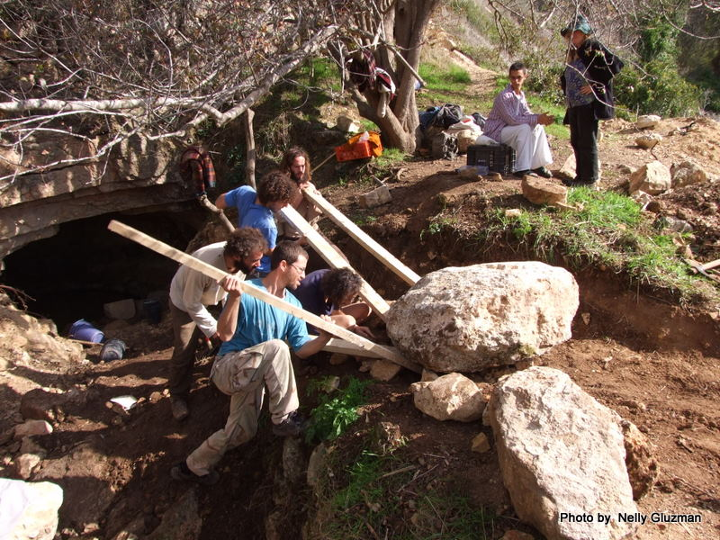 Yashar And Friends Hauling A Huge Rock Out Of Ein Sapir Springn Using Wooden Boards