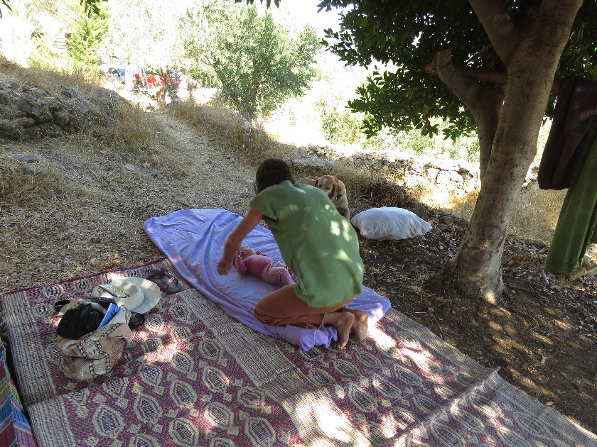 Yashar tending to baby in upper lot