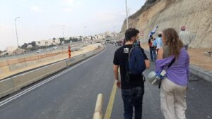 Destination ahead. Protesters along rt. 1. Submarine march Hemed Jerusalem
