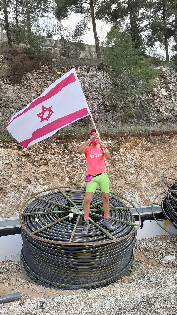 Getting close to the city. Pink Front protester on cables wheel