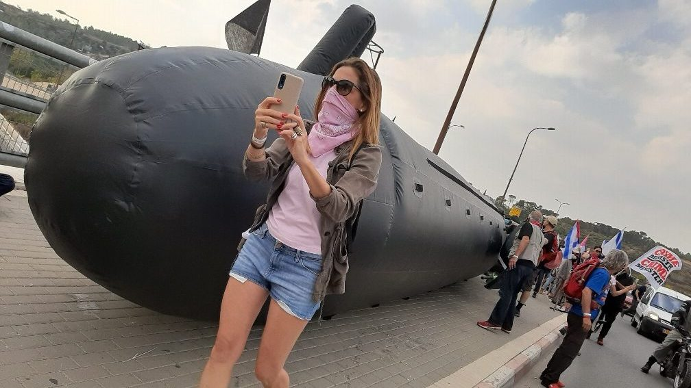 Protester in front of inflated submarine. Hemed Bridge